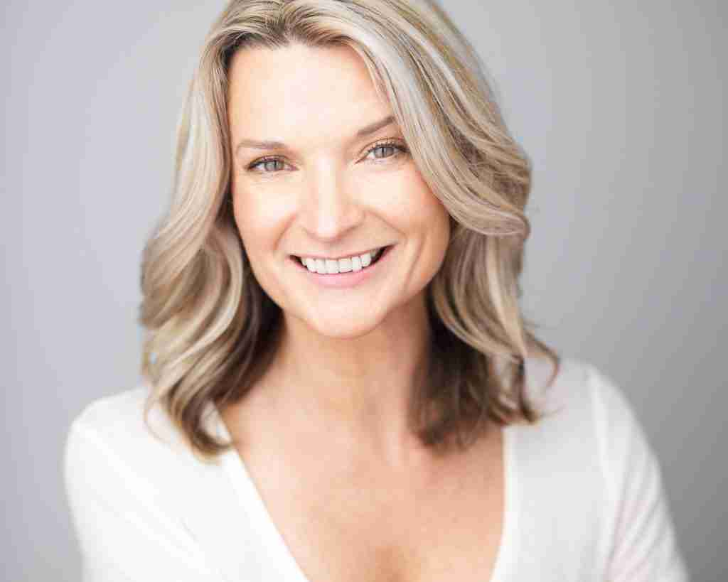 Andrea Powell smiling white shirt